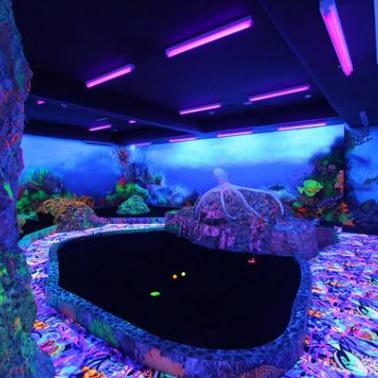 Sky experience adventuremelvins reef black light mini golf to swing and take it to the hole at crown regency hotels and towers black light mini golf black light mini golf a perfect hole day experience mozeypictures Image collections